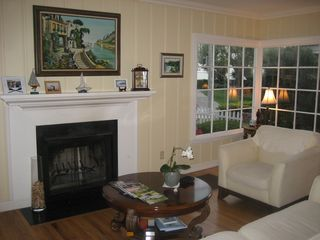 Naples house photo - Wood burning fireplace in living room.