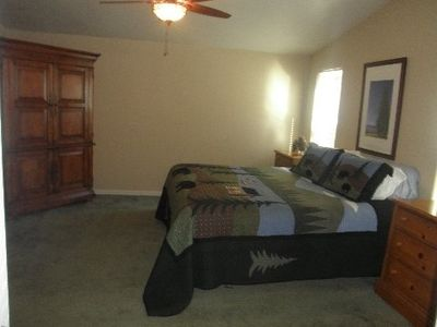 Spacious master bedroom with king bed, armoire with flat TV, DVD, Direct TV