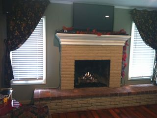 Den, with gas fireplace. New hardwood floor.