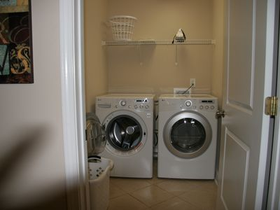 New LG front loading washer and dryer. Use he soap. Iron and board there too.