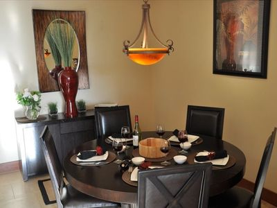 Enjoy meals in a large dining room with all the comforts of Home including place