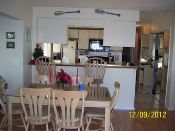 Dining Area and bar. Seating for 6 around table plus 2 bar stools at bar