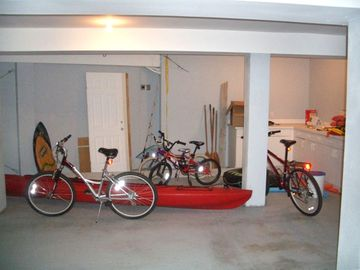 Oversized garage with fishing poles, bikes, etc.