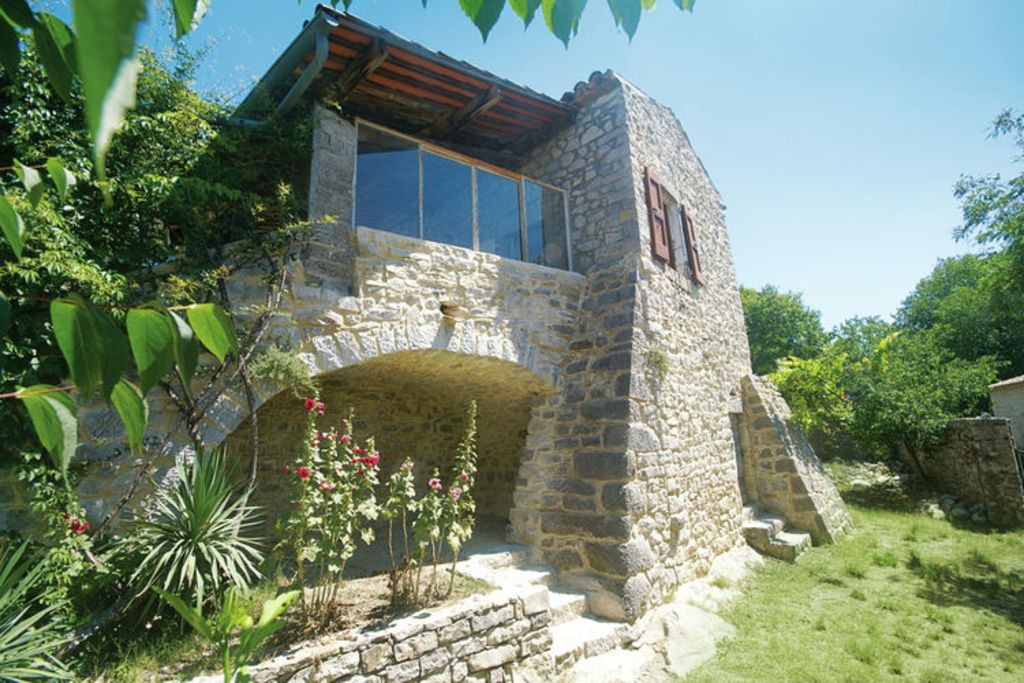 7 Amazing Houses Built Into Nature: Beautiful, Stone House, Built Into The Hillside In Nature