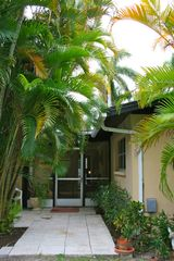 Naples house photo - Lush Landscaping