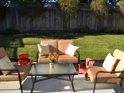 Outdoor living area with conversation set and kids furniture too.