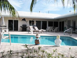 Pompano Beach house photo - Pool and huge patio with grille and chaise lounges
