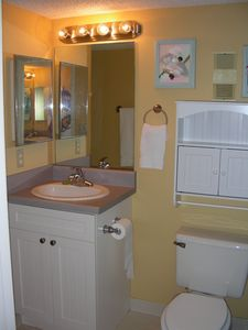 Full Bath, sink and cabinet area