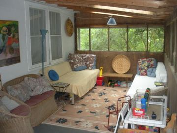 screened in porch on southside of house