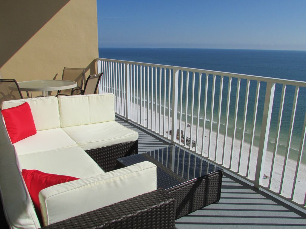 Updated condo on beach ocean view vrbo for Condo balcony furniture
