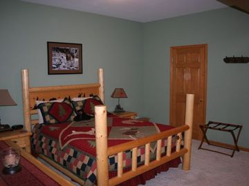 Main floor Bedroom with Queen Log Bed