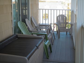 Large balcony with 7 adirondack chairs. Great place to hang out.