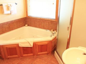 Oversized whirlpool tub in Master Suite.
