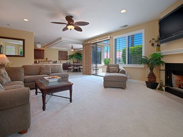 Palm Desert condo rental - Living Room with Entertainment Center and pull-out sofa bed.