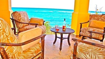 Seaside drinks in the covered pavilion, steps away from the wet bar