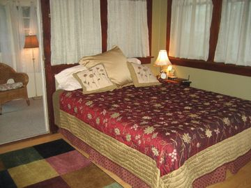 Queen bed with queen futon across room
