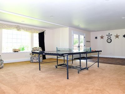 Large Rec Room with ping pong table & access to hot tub and theater room