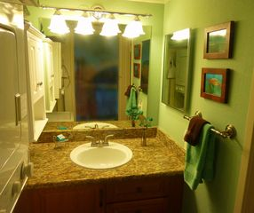 Kihei condo photo - Remodeled bathroom; granite with separated toilet & tiled shower area.