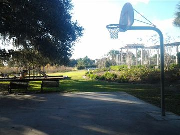 Playground and Basketball Court in a beautiful setting.