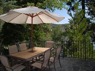 Table and chairs on the outside deck. - Lake Arrowhead house vacation rental photo