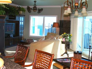 Daytona Beach Shores condo photo - Living room with HD Flat screen TV, Ipod Docking system. Ceiling fan and bar!