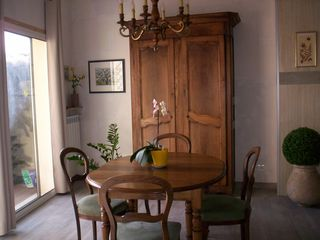 Dining area with antique Provencal walnut table and armoire. Terrace on left.