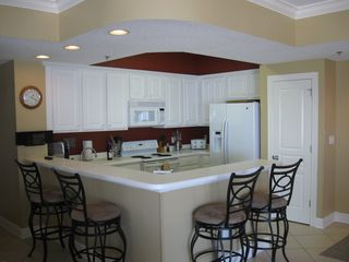 Orange Beach condo photo - Totally Updated Kitchen with All the Amenities of Home + a Gulf View!