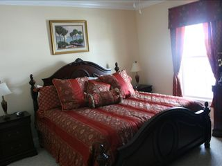 Surfside Beach house photo - Master Bedroom (main level) at front of home.Has large full bathroom-double sink