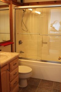 Bathroom has been updated with glass shower doors