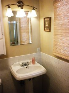 Bathroom with shower/tub combo, pedestal sink.