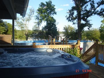 Fayetteville house rental - Soak in the hot tub after a long day tailgating or a dip in the pool.