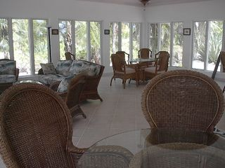 Governor's Harbour house photo - Spacious living area with windows all around to enjoy the view!