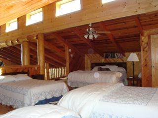 Clayton cabin photo - Loft bedroom sleeps 9-great breeze from high windows that open by remote control