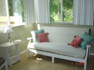 Cariboo cottage photo - Cabin 1 - The sitting room with bright view of the lake