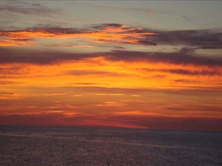 Redington Shores condo photo - Sunset from the balcony! Ahhhhh . . . so relaxing