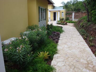 Walkway between main building with living area and kitchen to the bedrooms