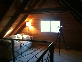 Walk across the indoor bridge to get to the loft, to read or stargaze.