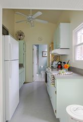 New Orleans studio photo - Galley style kitchen, bathroom beyond.