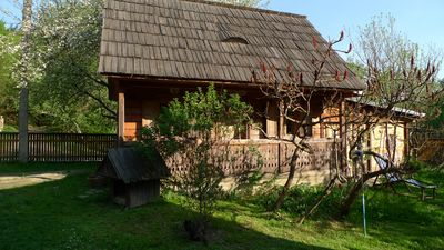 Romantic wooden house surrounded by the magnificent cultural landscape in Maramures
