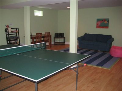 Playroom with ping pong table, toys and games for all ages