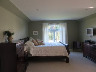 Charlottetown house photo - upstairs private bedroom. Queens sized bed with sitting area