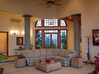 Playa Hermosa house photo - Living Room with Front Door in Back