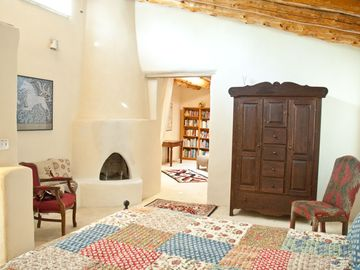Master bedroom with 2 rooms and kiva fireplace.