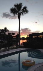 Vanderbilt Beach house photo - Sunset at poolside