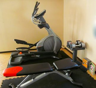 Fitness Area: Elliptical, Adjustable Weight Bench, 100lb. weights