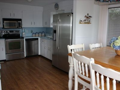 Fully equipped kitchen with all new stainless steel appliances and new flooring