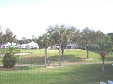 View of golf course from condominium screened-in lanai