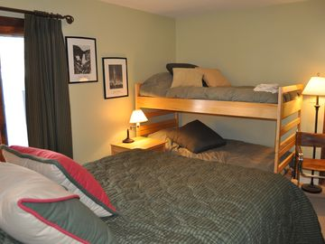 Queen bed with set of bunk beds with own full bath.