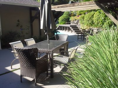 Patio with eating area and grill (not shown). Easy entertaining off the kitchen.