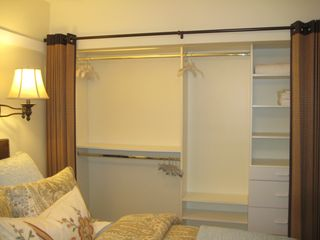 Long Beach apartment photo - Professionally organized closet for lots of storage